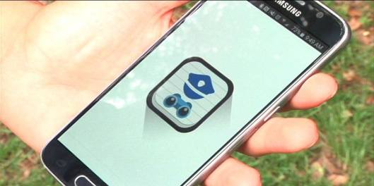 A smartphone with the loading page of POWER is held by Elbis Bolton, the developer of the police watchdog app.
