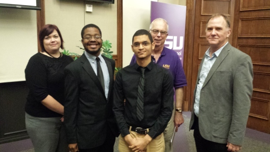 Winners of two awards for their police accountability mobile app pose with judges of the Social News Challenge awards. From left are Beth Colvin, award winners Wilborn Nobles and Elbis Bolton, Manship School Dean Jerry Ceppos and Chris Branton.